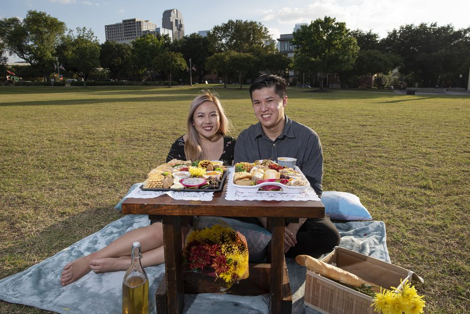 Chả Cutie co-owners Violet Huynh, of Garland, and Gavin Seto, of Richardson, show samples of their Vietnamese charcuterie at Griggs Park in Dallas.