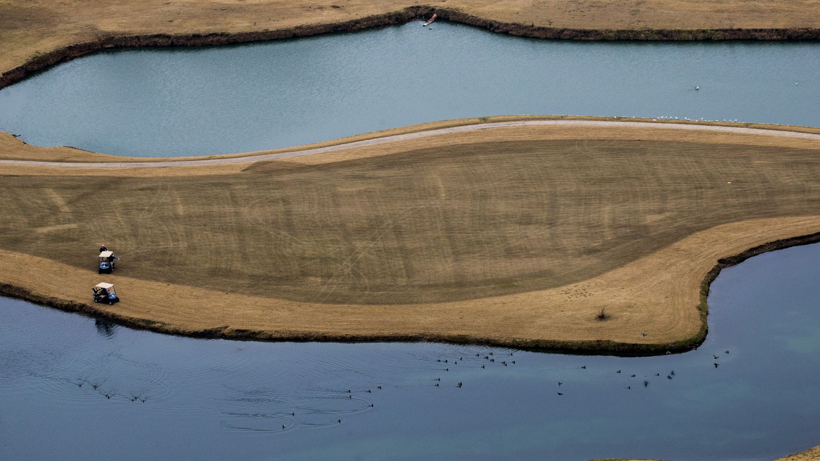 Men play golf at Firewheel Golf Park as photographed from a helicopter on Thursday, December 14, 2016 in Garland.