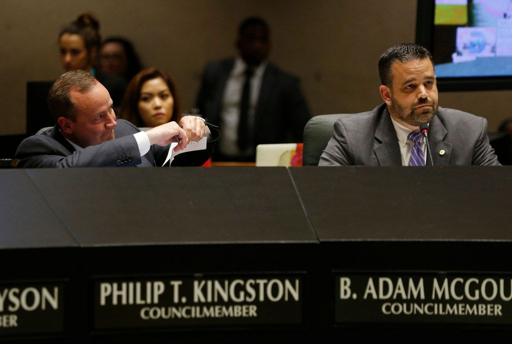 Dallas City council member Philip T. Kingston rips up a copy of an amendment proposed by Dallas City council member B. Adam McGough (right) about paid sick leave during a meeting at Dallas City Hall in Dallas on Wednesday, April 23, 2019. The City council voted on Wednesday to mandate Dallas businesses within the city limits to provide earned paid sick time to employees. (Vernon Bryant/The Dallas Morning News)
