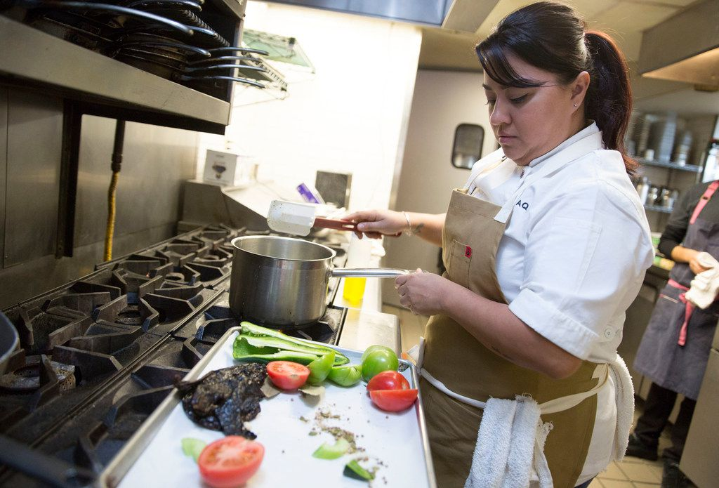 Cedars Social chef Anastacia Quinones prepares mole in her new role as chef at the revamped restaurant.