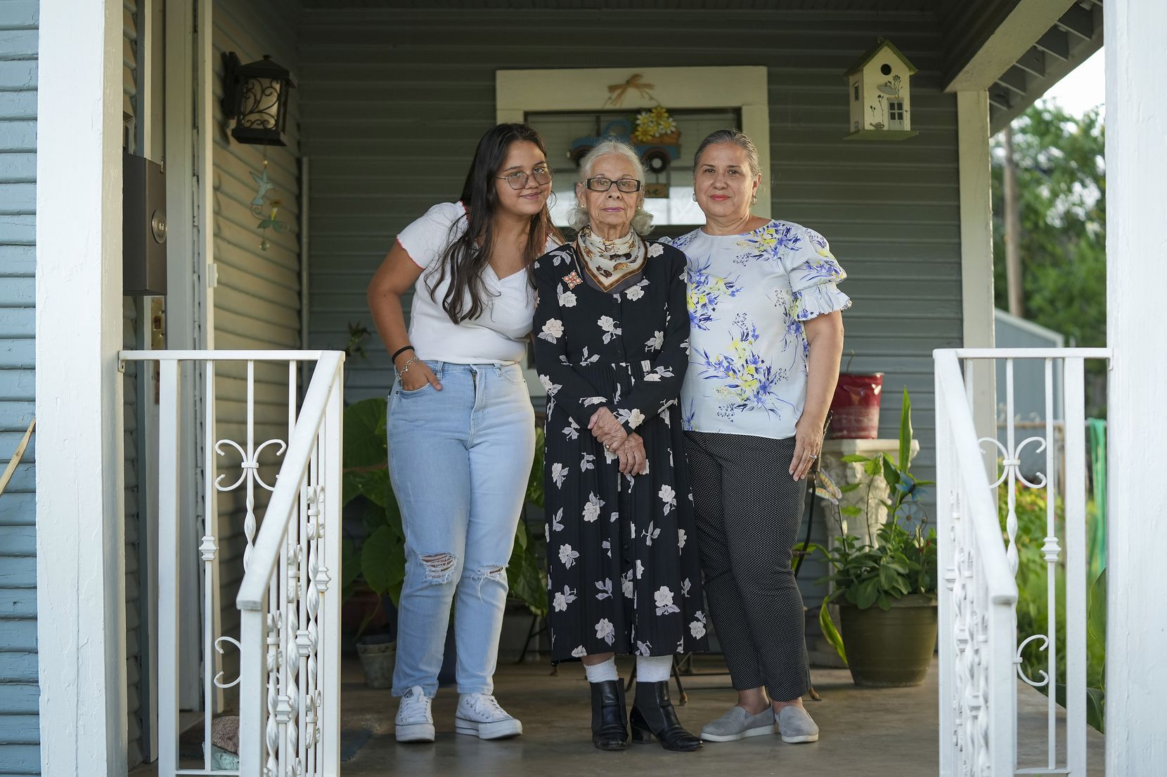 Alejandra Vila, 57, (right) photographed with her mother Olga Umana, 89, (center) and daughter Katherina De Leon, 14, on Thursday, July 15, 2021, in Dallas. Alejandra Vila and Olga Umana were among the first to be vaccinated at Fair Park on the first day of Dallas County's Fair Park mega vaccine site. Though it didn't happen at the Fair Park site, De Leon became the third generation of women in the family to be vaccinated when children over 12 were added in May to those Texans eligible for the shot. (Smiley N. Pool/The Dallas Morning News)