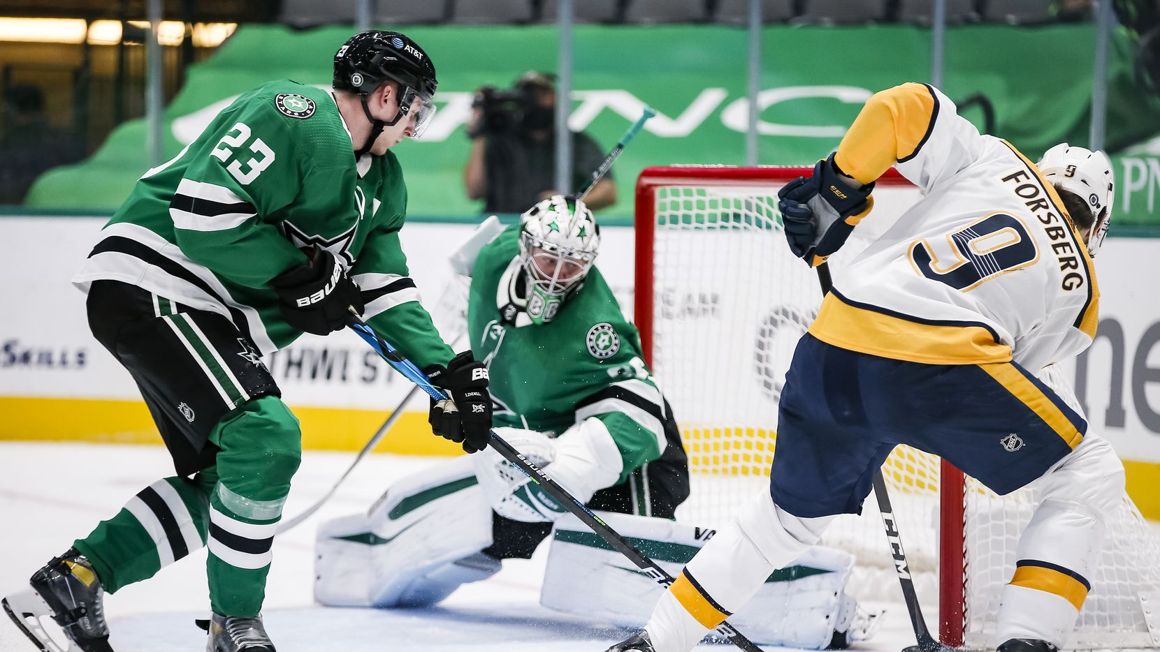 Nashville Predators forward Filip Forsberg (9) shoots the puck past Dallas Stars goaltender Anton Khudobin (35) as defenseman Esa Lindell (23) defends during the second period of an NHL hockey game in Dallas Sunday, March 21, 2021.