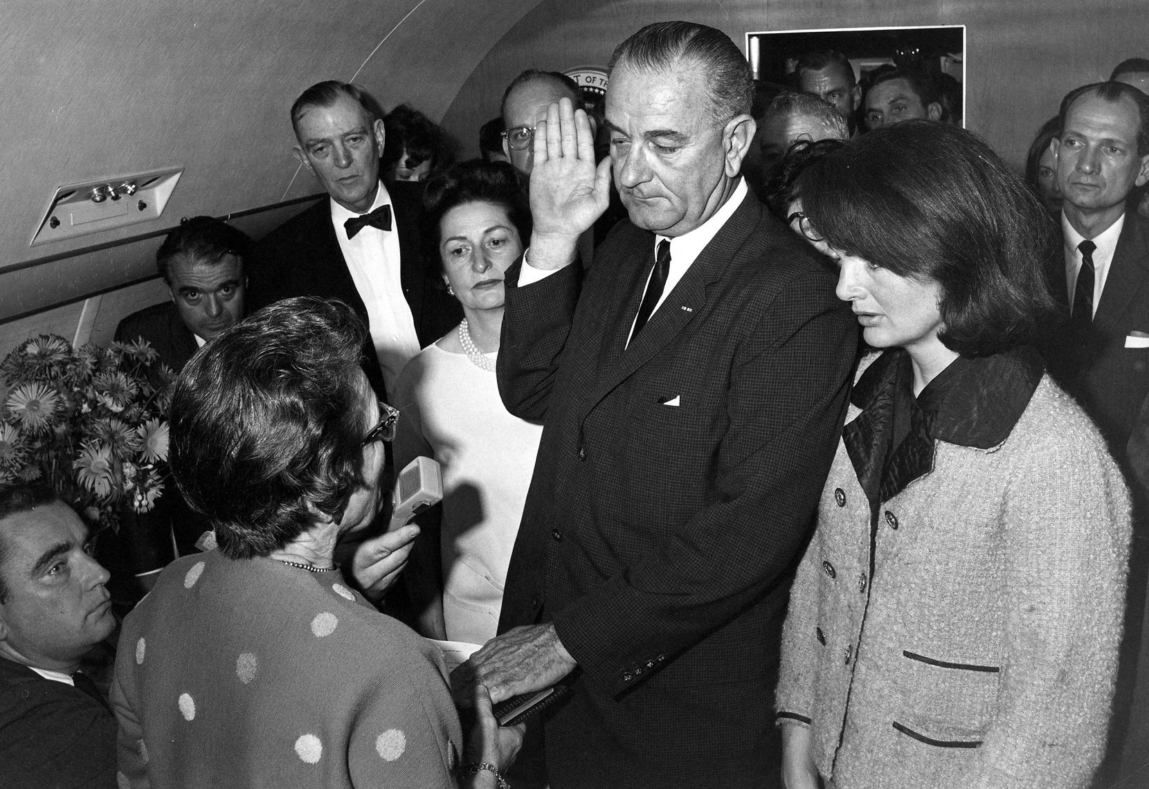 Judge Sarah T. Hughes administered the presidential oath of office to Lyndon Johnson aboard Air Force One at Love Field after John F. Kennedy's death. Johnson's wife, Lady Bird (background), and the slain president's widow, Jackie Kennedy, were among the witnesses.