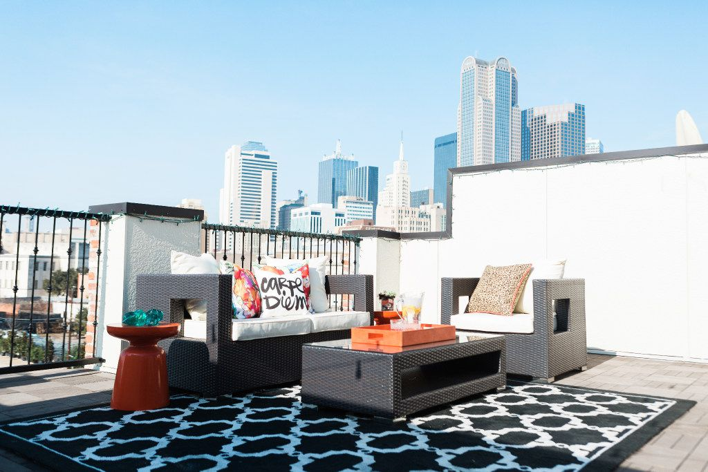 Personalize your outdoor space with pillows, rugs and umbrellas, suggests Dallas designer Abbe Fenimore.