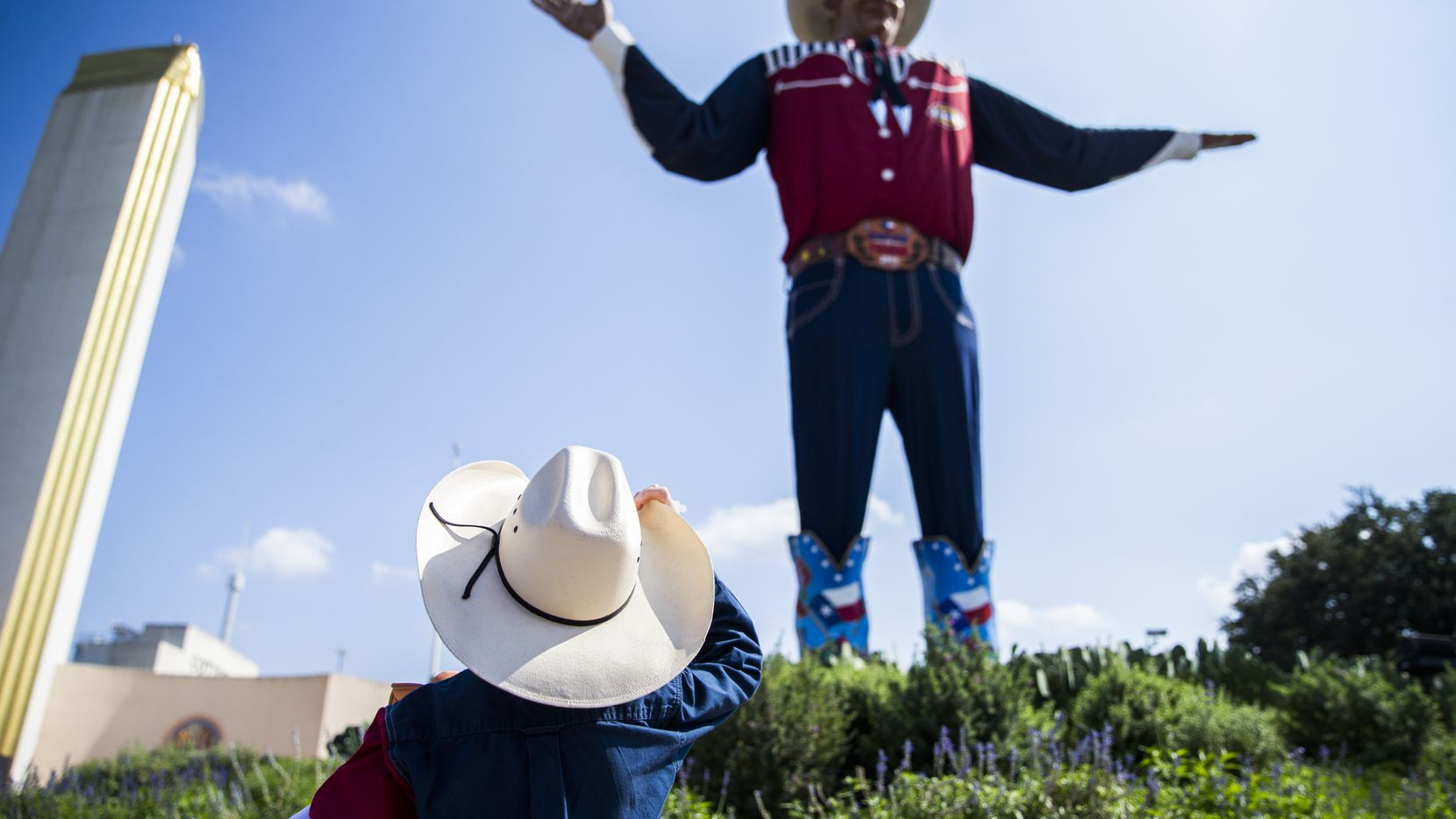 Isaiah Lee, 6, of Weatherford looks up at Big Tex at the State Fair of Texas on Friday, October 4, 2019 at Fair Park in Dallas. (Ashley Landis/The Dallas Morning News)