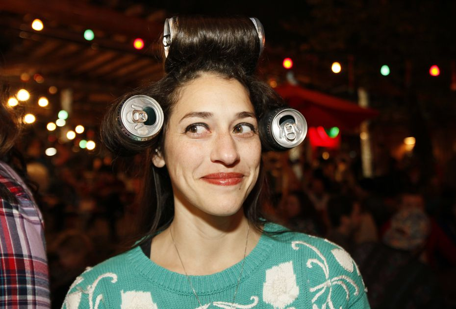Megan Muller shows off her homemade 'white trash' hair rollers during the Truck Yard's White Trash Christmas Party and Ugly Christmas Sweater contest in 2014.