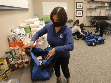 Florencia Velasco Fortner fills bags with necessities at the Concilio in Dallas. She is president and chief executive of the nonprofit.