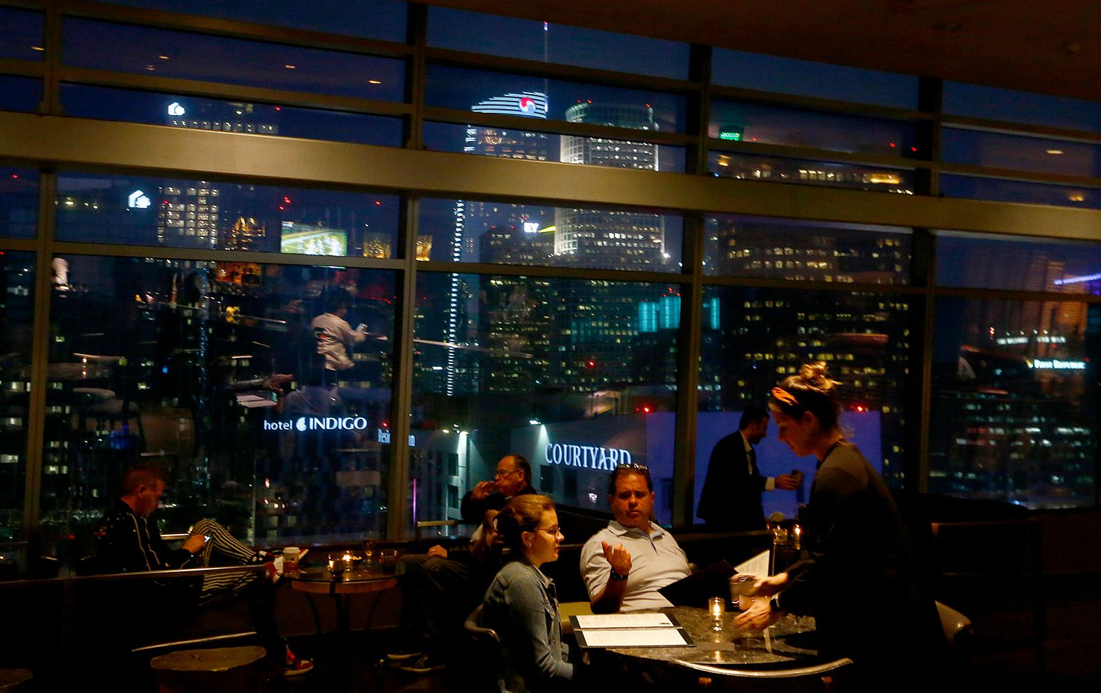 Guests dine with a stellar view of downtown Los Angeles at WP24 by Wolfgang Puck in the Ritz-Carlton Hotel at L.A. Live.