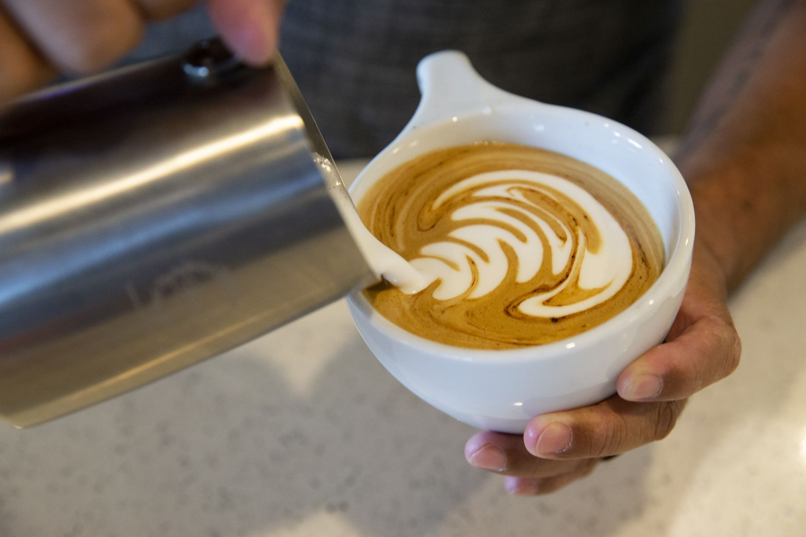 Angelo Europe makes a Micah Mocha at Grounds & Gold Coffee Co. on Sept. 14, 2020 in Arlington.