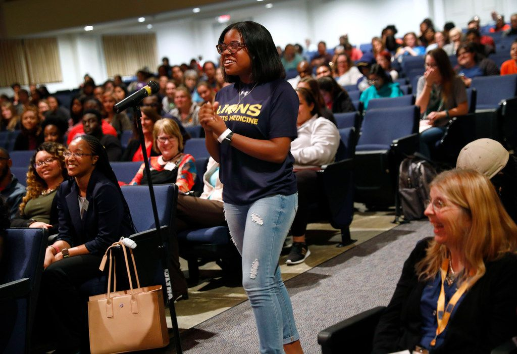 Texas A&M Commerce Responsible Lions member Lakeyra Whitney listens to keynote speaker Kevin Hines respond to her question during mental health awareness day. The Responsible Lions club is a group of campus athletes dedicated to reaching out to peers in need.