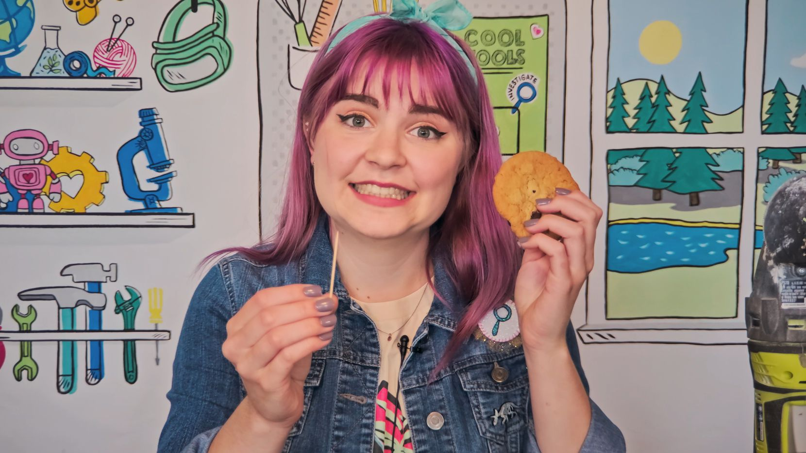 """Myria Perez shows kids how to remove a chocolate chip """"fossil"""" from a cookie """"rock"""" in her Curiosity Camp video with GoldieBlox."""