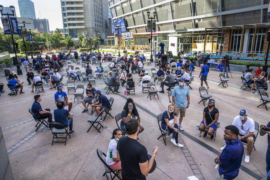 """FILE - Attendees participate in small group discussions about systemic racism during a """"Courageous Conversations"""" meetup at Victory Plaza outside American Airlines Center in Dallas on Tuesday, June 9, 2020."""