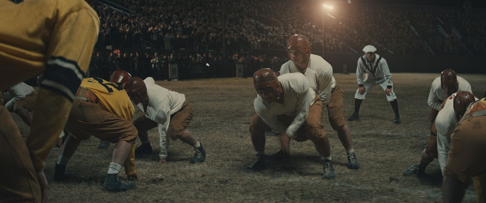 """The Mighty Mites line up on offense against the Amarillo Sandies in a scene from the forthcoming about Texas high school football titled """"12 Mighty Orphans."""""""