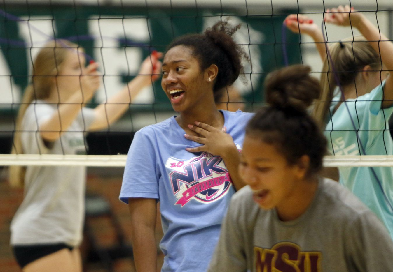 Alex Youngblood shares her excitement with teammates during conditioning drills in conjunction with the season opening volleyball practice for the Kennedale Lady Kats. Under the direction of head coach Kelly Carl, the team conducted their drills Kennedale High School in Kennedale on August 03, 2020.(Steve Hamm/ Special Contributor)