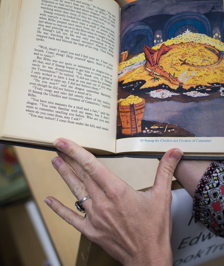 Laurel Crawford, head of collection development at the University of North Texas Libraries, shows illustrations drawn by J.R.R. Tolkien in the 1938 edition of his fantasy novel.