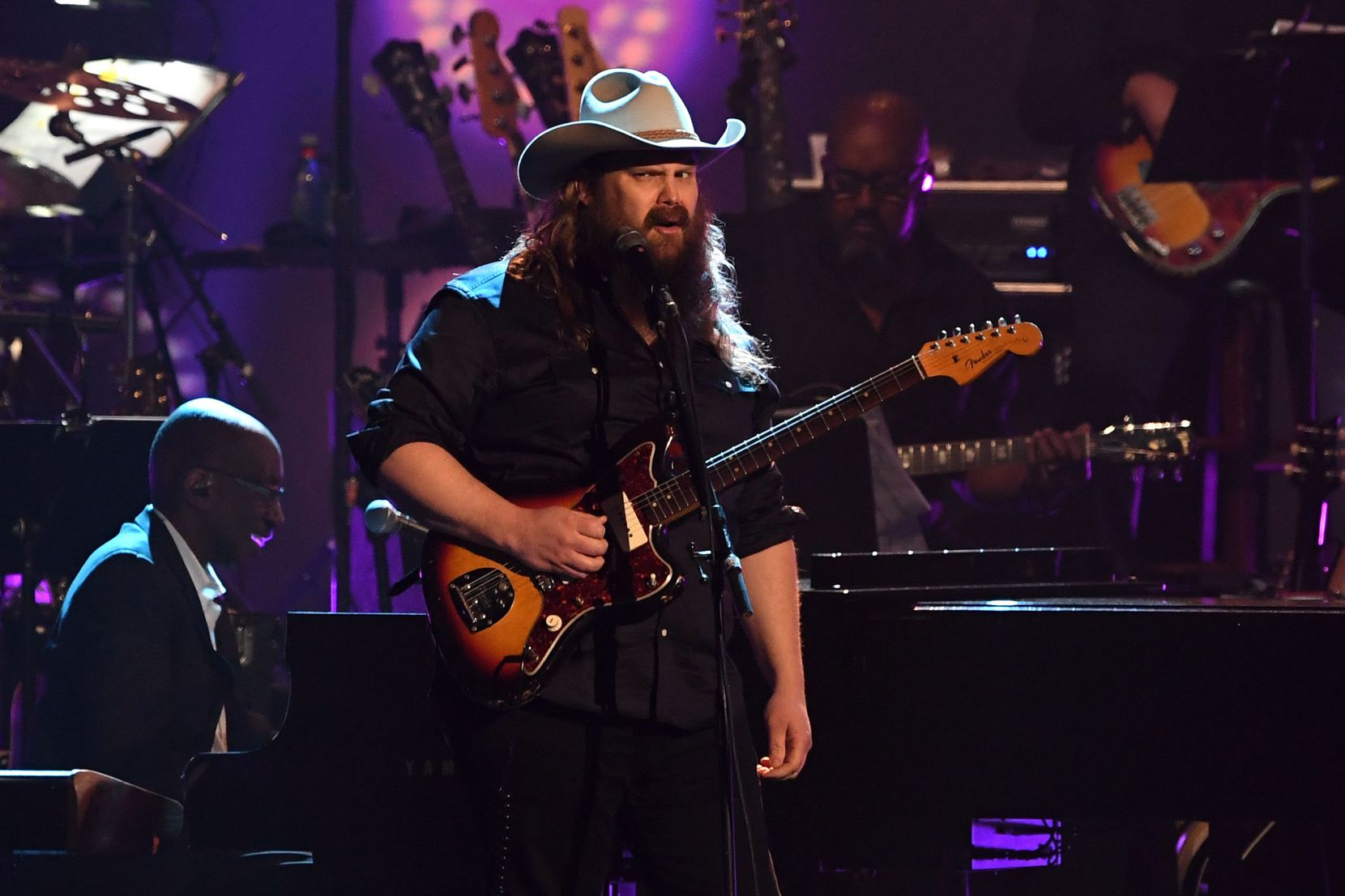 Chris Stapleton performed onstage at the 2019 MusiCares Person of the Year gala at the Los Angeles Convention Center on Feb. 8, 2019. The 2019 MusiCares honored U.S. singer-songwriter Dolly Parton as the Person Of The Year.