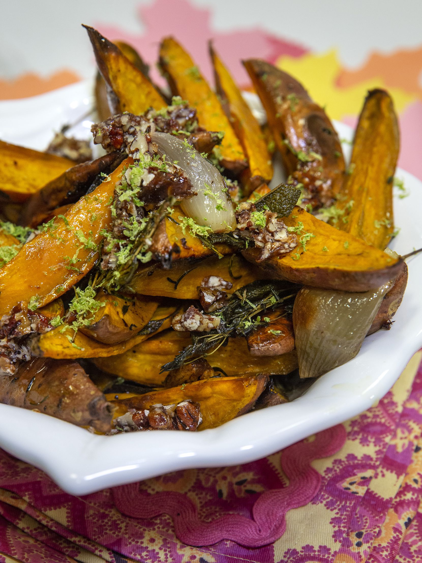 Roasted Sweet Potatoes and Shallots is topped with lime zest and Spicy Pecans.