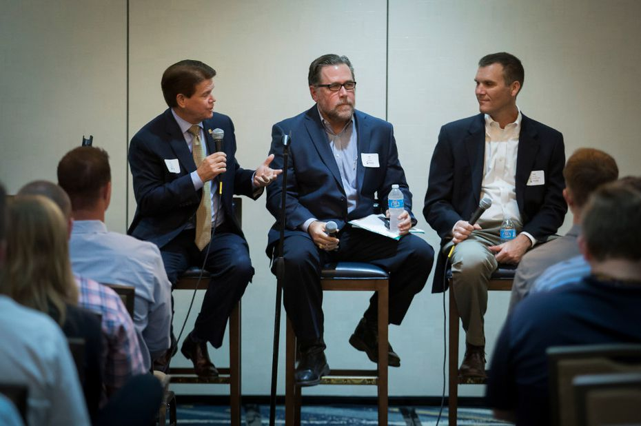 From left: Arlington Mayor Jeff Williams, Jack Hill, the Rangers' senior vice president of project development, and Mark Penny, senior vice president for Texas at Manhattan Construction, participate in a panel discussion about the new Rangers stadium and Texas Live development.