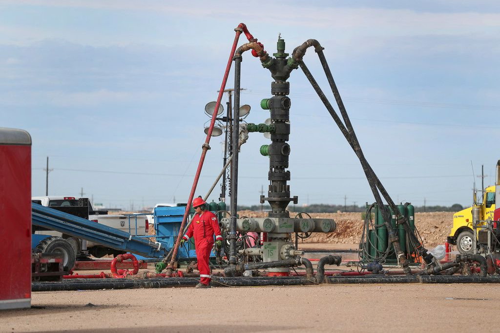 In a June 26, 2017 photo, a Halliburton wellhead is visible at a fracking site in Midland.