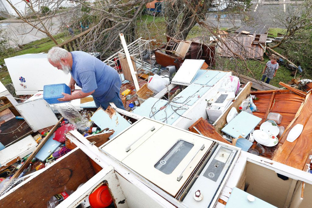 Bill and Paulette Rogers search the second story of their home for his wallet after Hurricane Harvey destroyed their house in Port Aransas, Texas on Aug. 26, 2017.   (Nathan Hunsinger/The Dallas Morning News)
