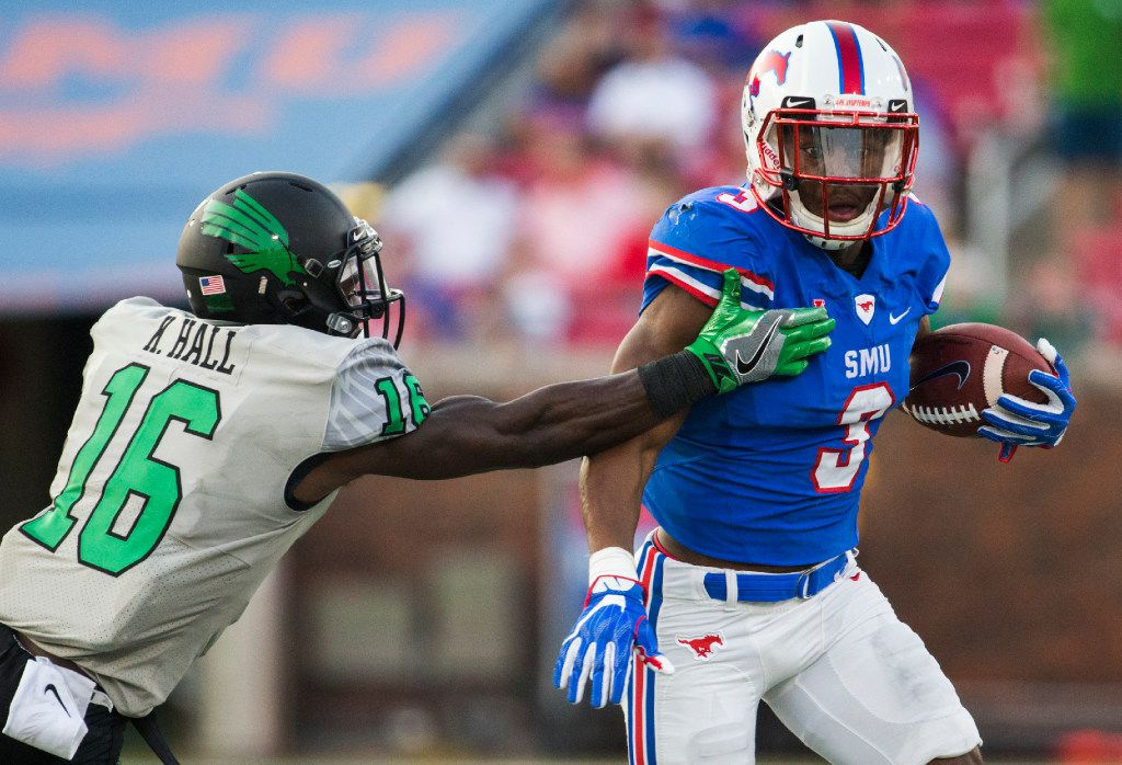 North Texas Mean Green defensive back Kemon Hall (16) tackles Southern Methodist Mustangs wide receiver James Proche (3) during the second quarter of a football game between UNT and SMU on Saturday, September 9, 2017 at SMU's Ford Stadium in Dallas. (Ashley Landis/The Dallas Morning News)
