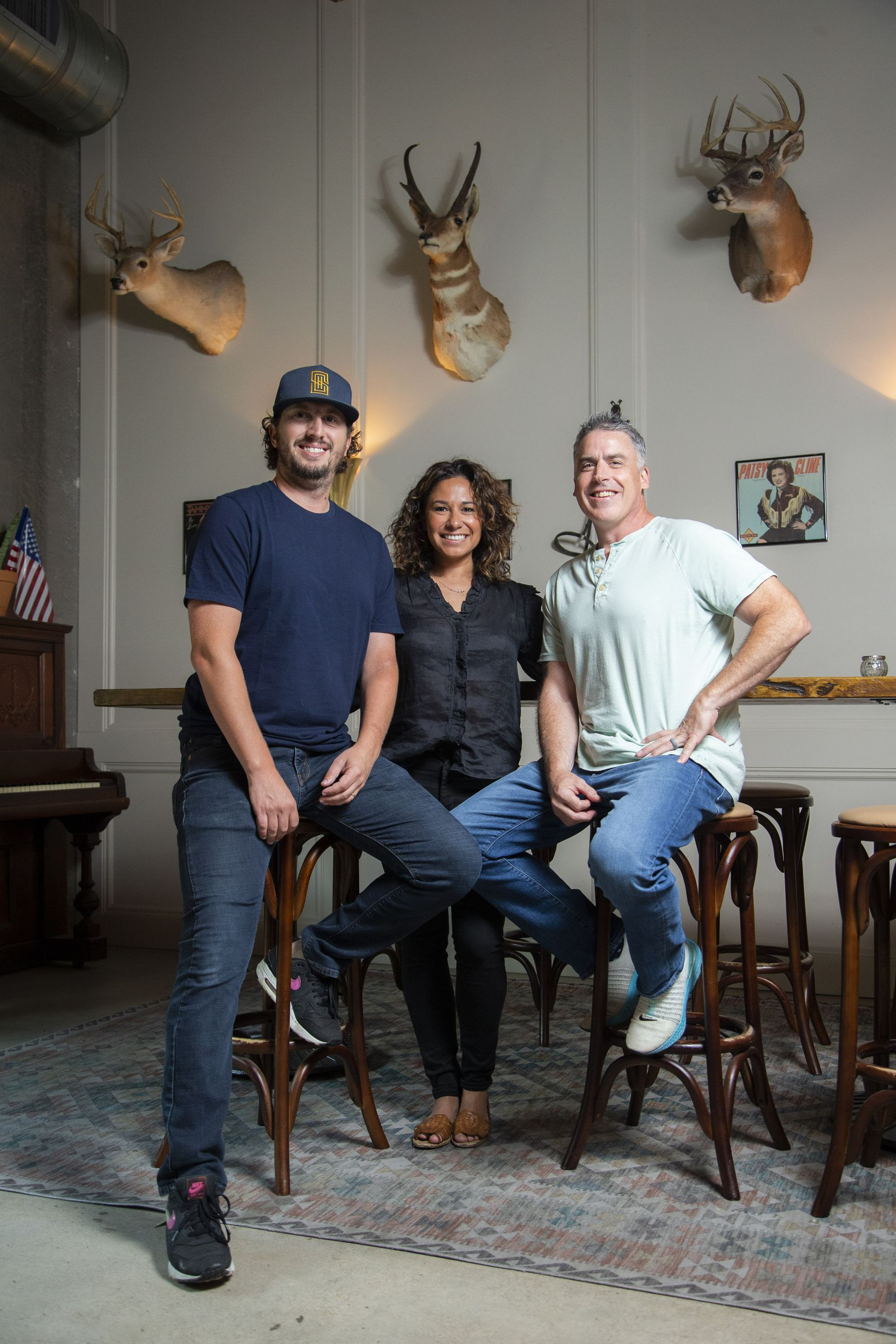 Managing partners Christian Lehrmann, Sarah Castillo and Glen Keely pose for a photo at Side Saddle in the Fort Worth Stockyards.