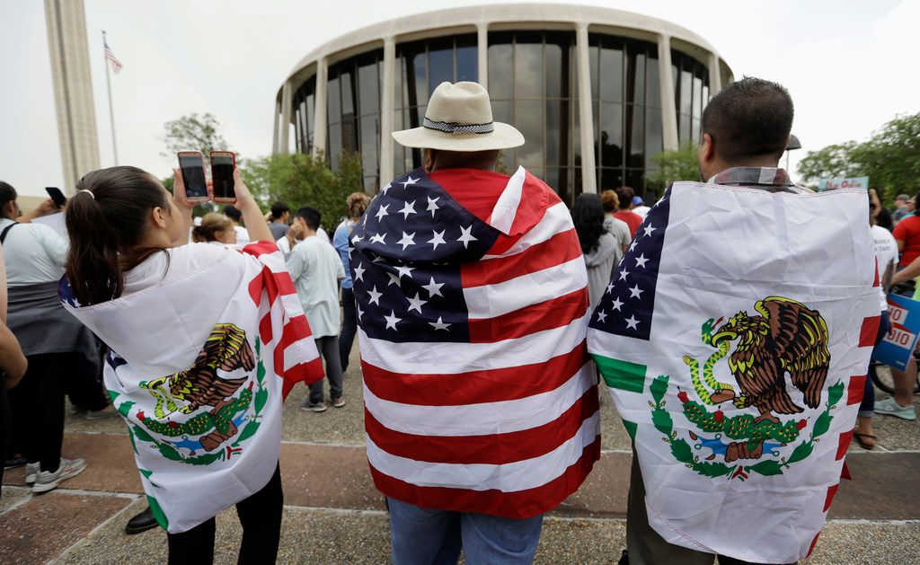 """Protesters rally in June outside the federal courthouse in San Antonio to oppose a new law passed by the Texas Legislature banning """"sanctuary cities"""" for undocumented immigrants."""