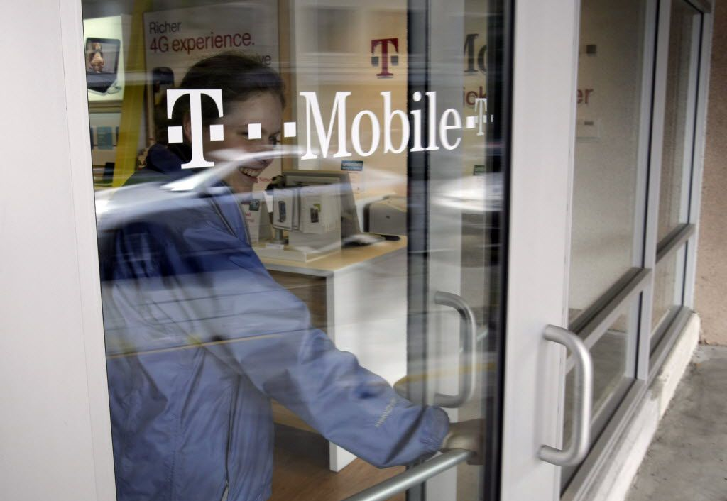 A customer walks out of a T-Mobile store in Palo Alto, Calif., Friday, Feb. 25, 2011. Subscribers on contract-based cell phone plans hung up on T-Mobile USA in record numbers in the fourth quarter, as it continues to lose the battle against larger carriers. (AP Photo/Paul Sakuma) 03232011xALDIA