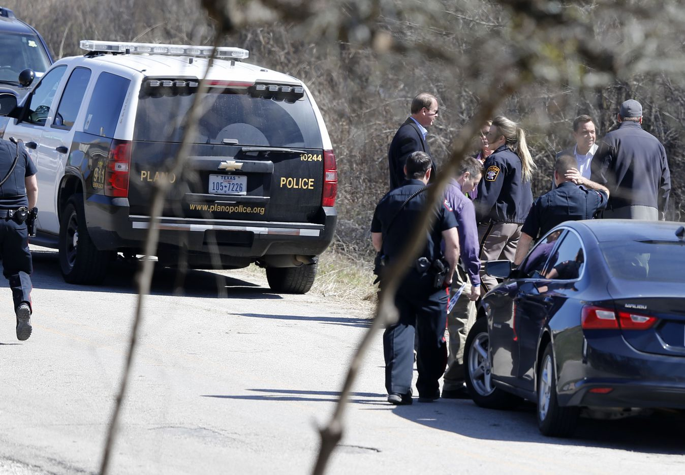 Plano police at the scene where possible human remains were found near the intersection of Taylor Blvd. and Mesquite Lane, in Anna, Texas on Wednesday, March 7, 2018.