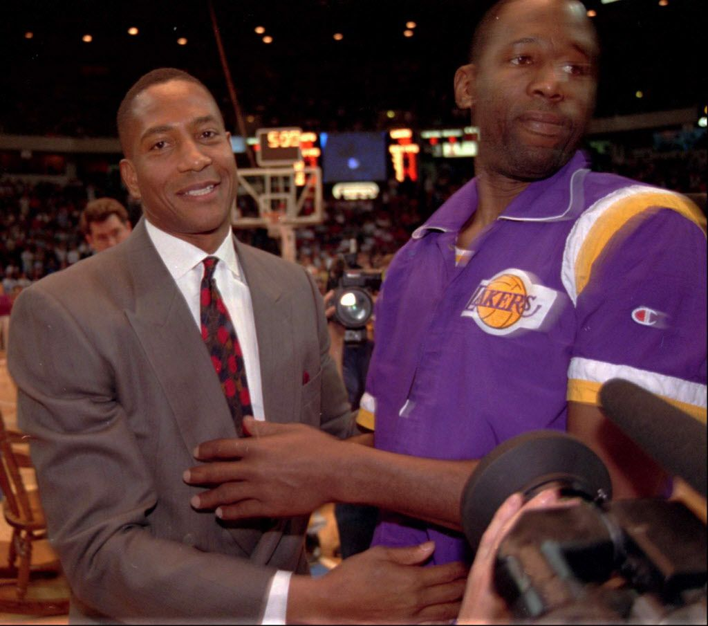 Denver Nuggets scoring standout Alex English, left, is congratulated by Los Angeles Lakers forward James Worthy at the retirement ceremony for English's Nuggets' number in this file photograph taken on March 2, 1993. English was one of seven people elected to the Basketball Hall of Fame on Monday, Feb. 3, 1997. English, who spent most of his 15 years in the NBA with the Nuggets, was the first player in the NBA to score 2,000 points in eight straight seasons.