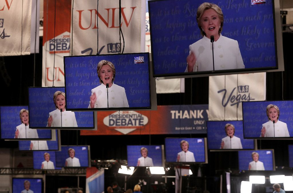 Democratic presidential nominee former Secretary of State Hillary Clinton appears on television screens in the media center during the third U.S. presidential debate at the Thomas & Mack Center on October 19, 2016 in Las Vegas, Nevada.