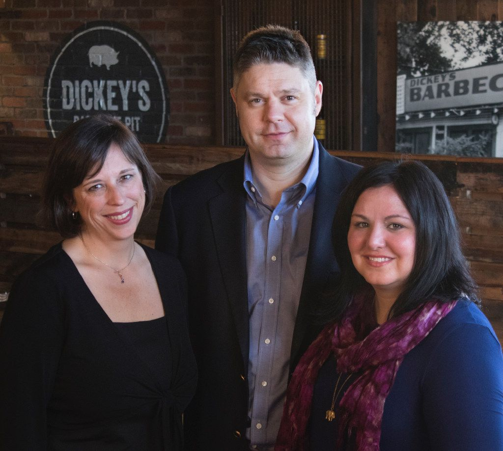 Renee Roozen (left), brand president of Dickey's Barbecue Restaurants Inc.; Roland Dickey Jr., CEO of the parent company, Dickey's Capital Group; and Laura Rea Dickey, CEO of the restaurant company, at the Wycliff location.