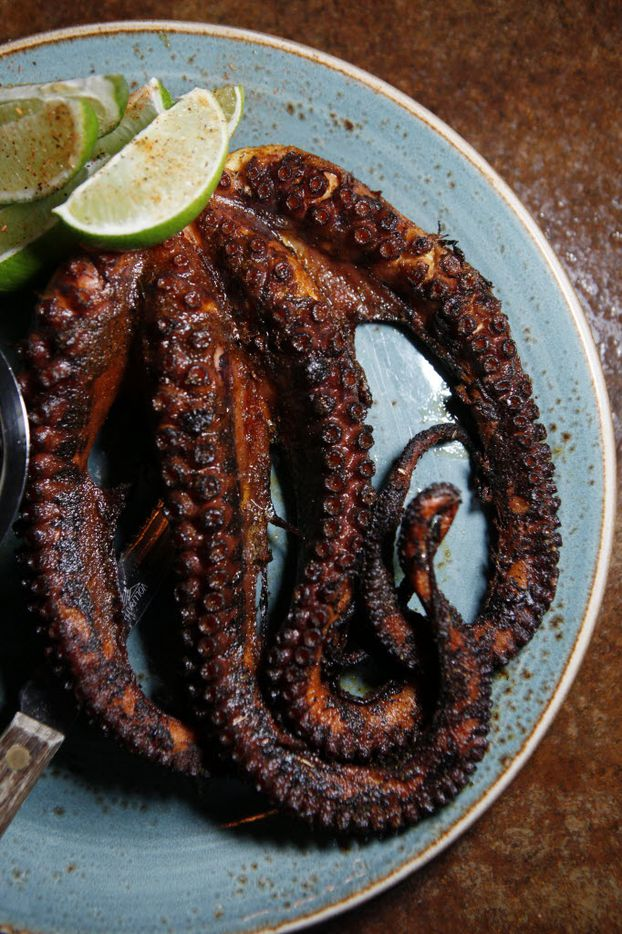 Charred pulpo (octopus) simmered in white wine and Spanish spices