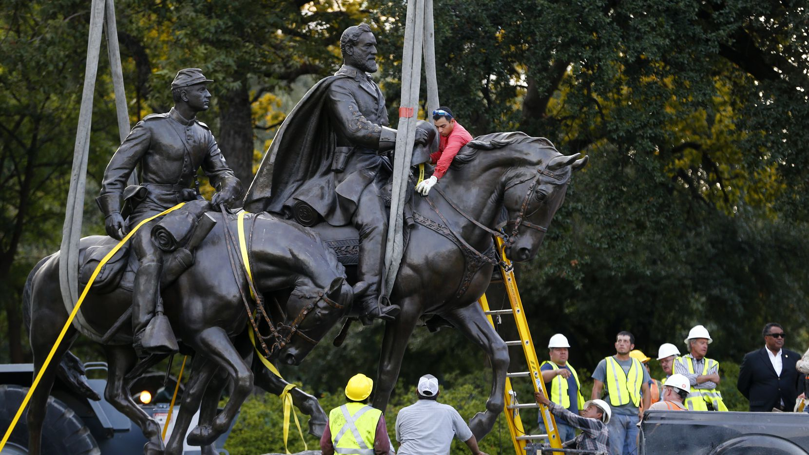 Workers harness the Robert E. Lee statue to a trailer for its removal from Robert E. Lee Park in Dallas on Sept. 14, 2017.