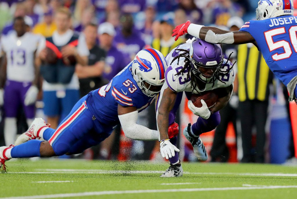 ORCHARD PARK, NY - AUGUST 29:  Tyrel Dodson #53 of the Buffalo Bills dives to make a tackle on Mike Boone #23 of the Minnesota Vikings as he runs the ball in the first half of a preseason game at New Era Field on August 29, 2019 in Orchard Park, New York.  (Photo by Timothy T Ludwig/Getty Images)