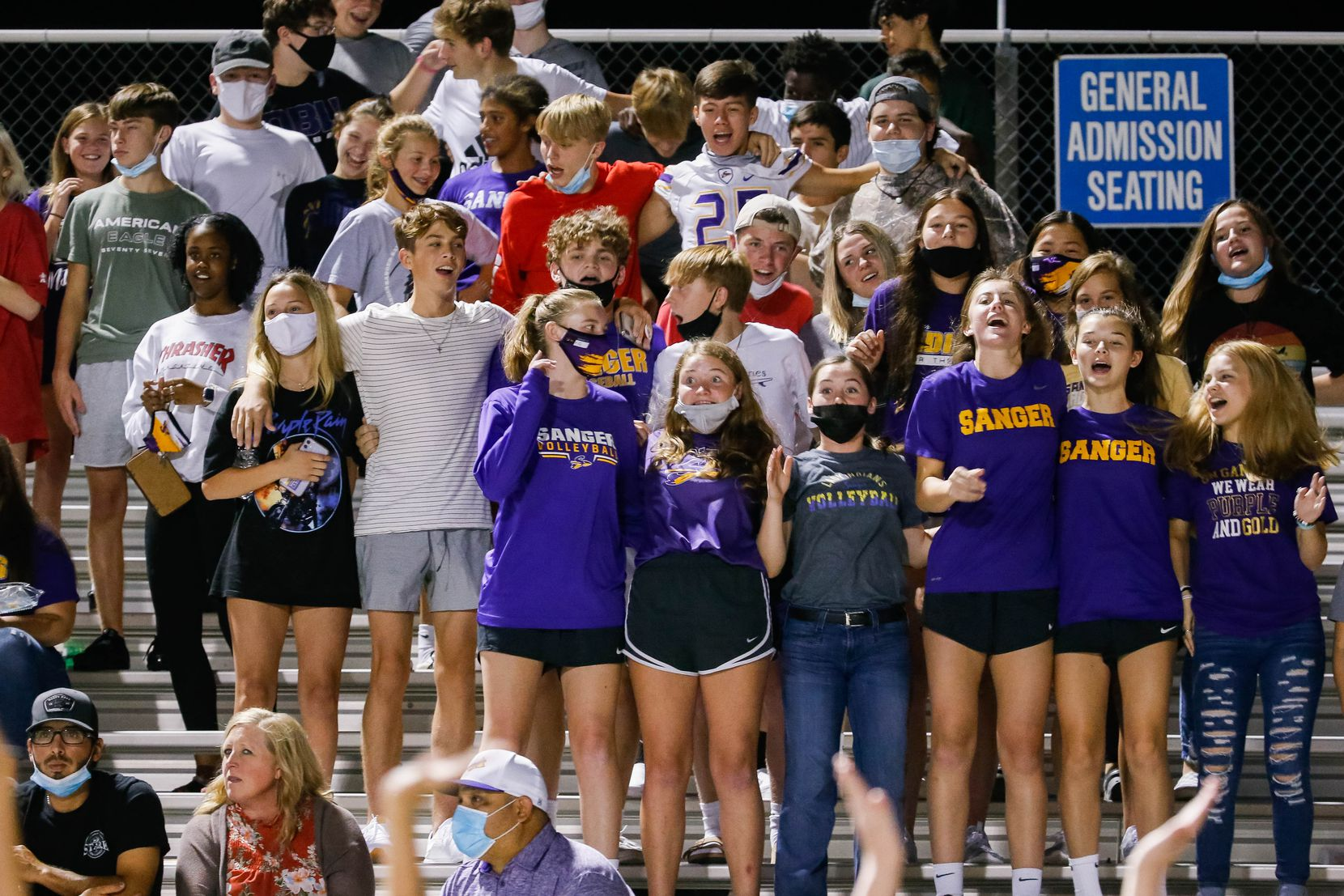 Sanger High School students watch a game against Lake Worth High School's during the second half of a game on Sept. 4, 2020 in Sanger. Sanger leads 26-14 at halftime. (Juan Figueroa/ The Dallas Morning News)
