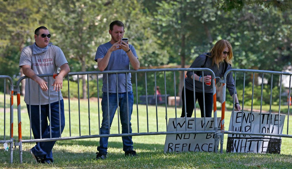 From left to right: On Monday John Storm, William Fears and Reagan Watson protested the removal of the Robert E. Lee statue from Oak Lawn
