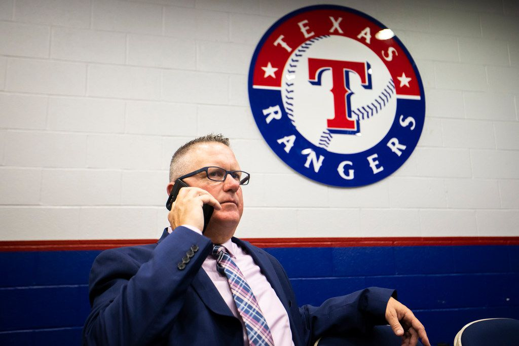 Texas Rangers Senior Director of Amateur Scouting Kip Fagg talks on the telephone after the team announced the signings of several of the club's draft picks from last week's MLB draft at Globe Life Park on Tuesday, June 12, 2018, in Arlington. (Smiley N. Pool/The Dallas Morning News)