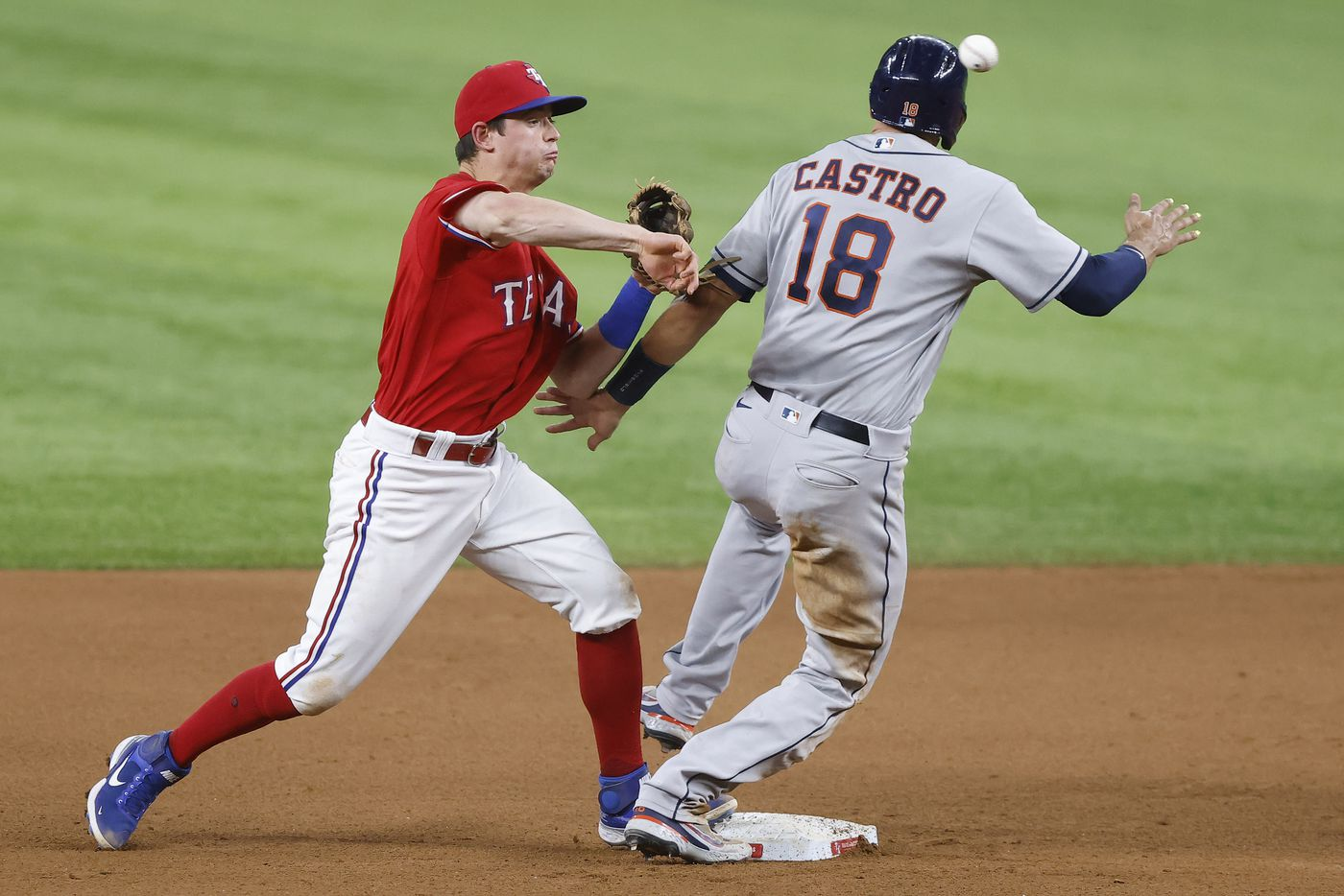Texas Rangers second baseman Nick Solak (15) turns the front end of a double play attempt to get Houston Astros catcher Jason Castro (18) at second in the the seventh inning at Globe Life Field in Arlington, Texas, Friday, May 21, 2021. Houston Astros batter Jose Altuve was safe at first. (Tom Fox/The Dallas Morning News)