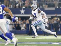 Dallas Cowboys cornerback Trevon Diggs (7)  returns a third quarter interception against the New York Giants at AT&T Stadium in Arlington, Texas, Sunday, October 10, 2021.