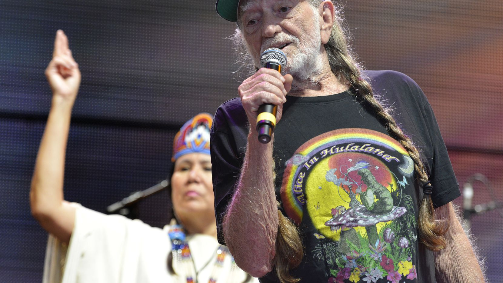 Willie Nelson recites the Lord's Prayer at Farm Aid 14 in Raleigh, N.C., Saturday, Sept. 13, 2014.