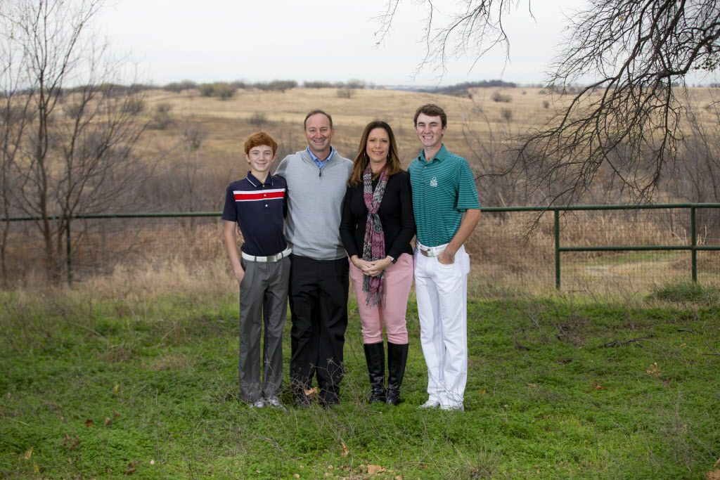 David Ovard, his wife, Wren, and their two sons Davis, 13, (left) and Dawson, 17, stand on land that will become the site of one of two golf courses in northern Frisco.