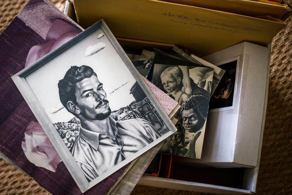 A box of materials related to Michael G. Owen Jr., including a photograph of a self-portrait, are seen at David Dike Fine Art  on Thursday, Sept. 12, 2019, in Dallas.  The gallery has recently come into possession of a number of materials by the Depression-era Dallas artist. (Smiley N. Pool/The Dallas Morning News)