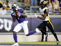 FILE - TCU receiver Jalen Reagor (1) reels in a long touchdown in front of Arkansas-Pine Bluff defensive back Jordan Brown (29) during the third quarter of a game at Amon G. Carter Stadium in Fort Worth on Saturday, Aug. 31, 2019.