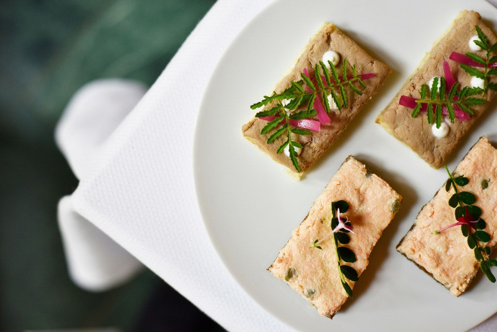 Sandwiches of duck confit with foie gras, top, and salmon rillette with capers, bottom, from the French Room inside the Adolphus Hotel in Dallas, June 9, 2019.