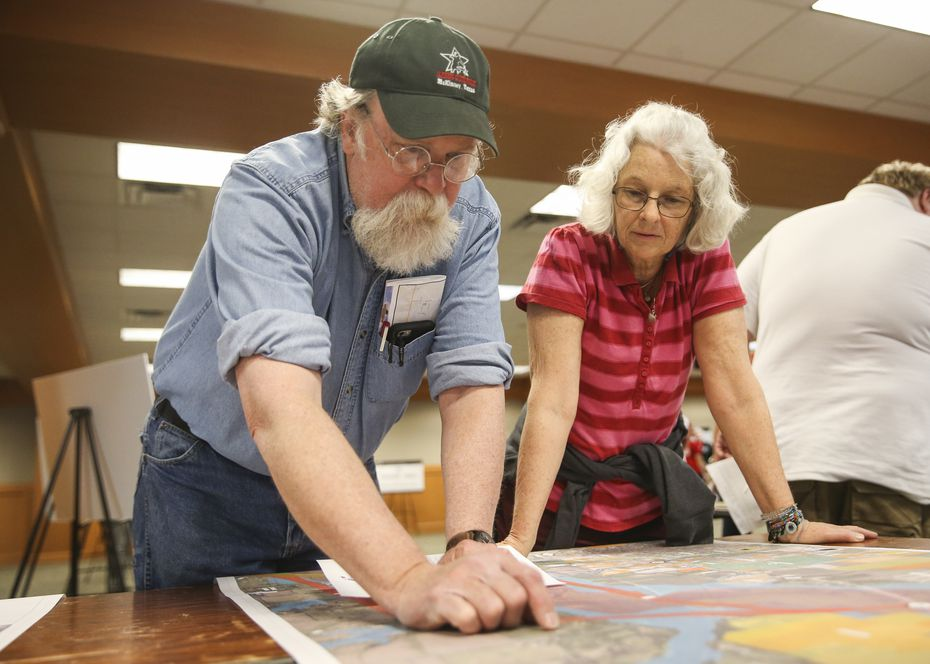 Gordon and Margaret O'Neal discuss how potential routes for a U.S. 380 bypass could interact with their property while looking at an alignment map displayed during a Texas Department of Transportation open house to display new U.S. 380 alignment maps Thursday, March 21, 2019 at the Russell A. Steindam Courts Building in McKinney.