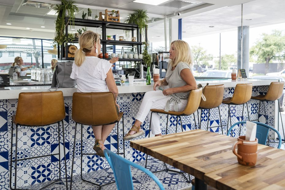 Leslie Roppolo, left, and Jenny Phillips have a drink at the bar area inside Public Taco in Dallas.