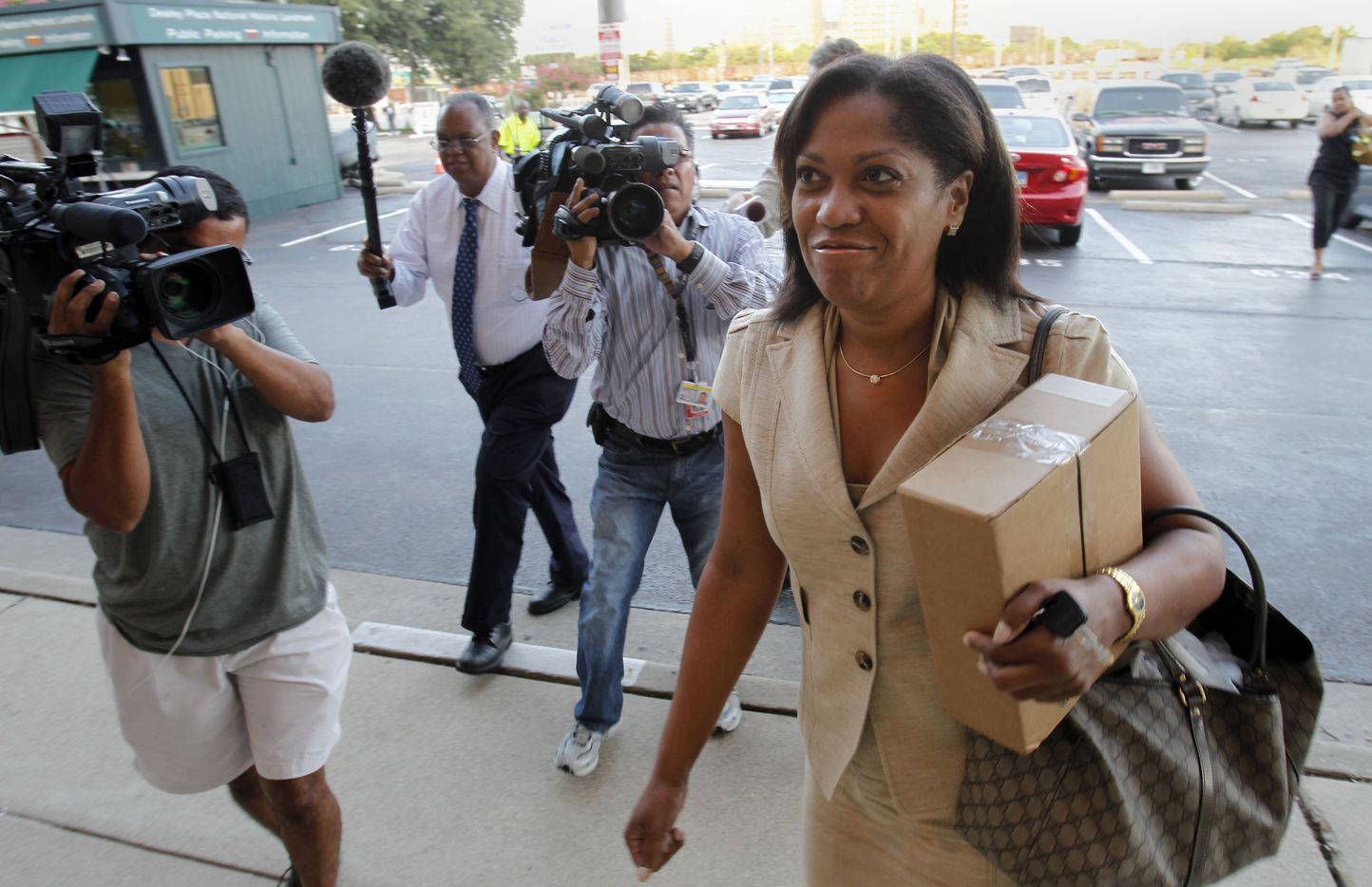 """Dapheny Fain, top assistant to Dallas County commissioner John Wiley Price arrives at the Dallas County Administration building in June, 2011. Price vowed at the time that it would be """"county business as usual,"""" as he carried on his duties under the cloud of an FBI investigation."""