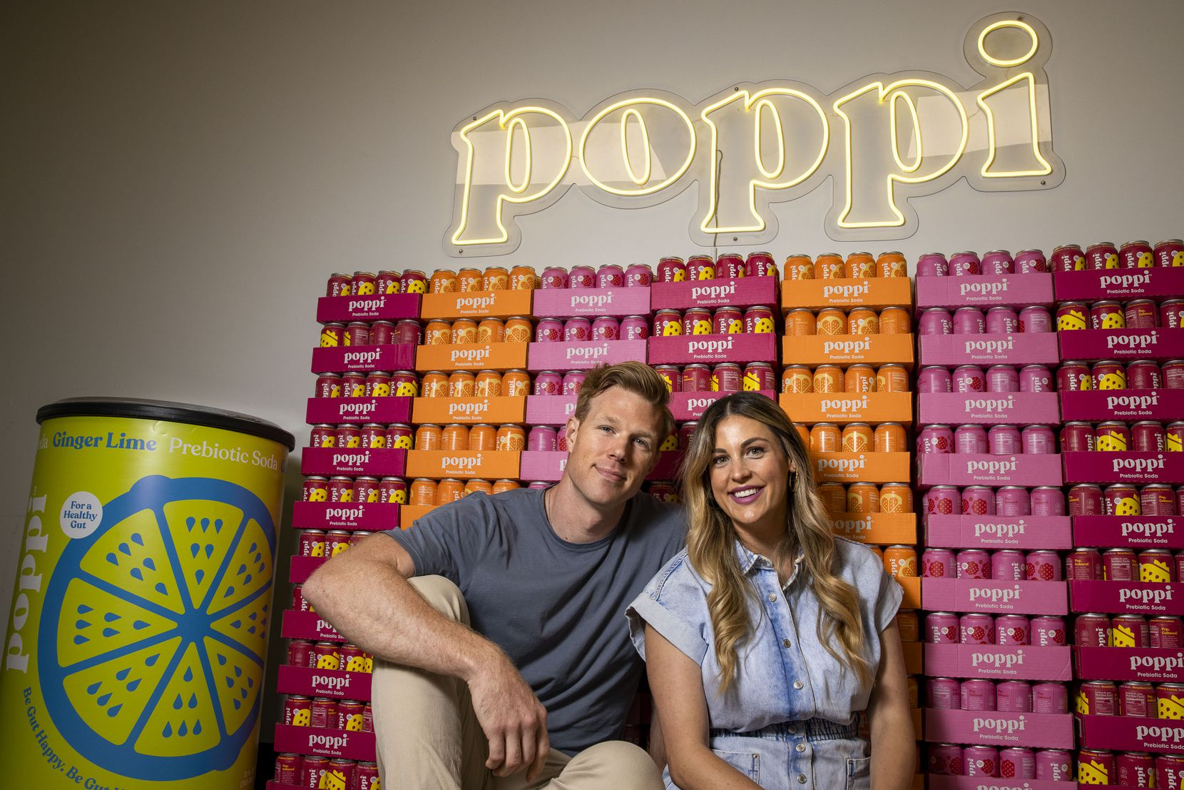 Husband and wife team Stephen, left, and Allison Ellsworth pose for a portrait at the poppi office located in Dallas on Thursday, July 1, 2021. Poppi is a Dallas-based probiotic drink company that started out at local farmers markets and is now growing across the country. (Lynda M. González/The Dallas Morning News)