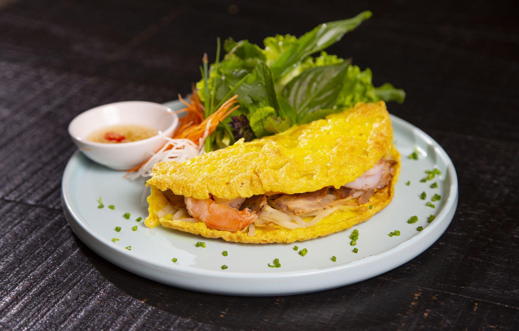 Bánh xèo is a Vietnamese crepe made with shrimp and sliced pork.